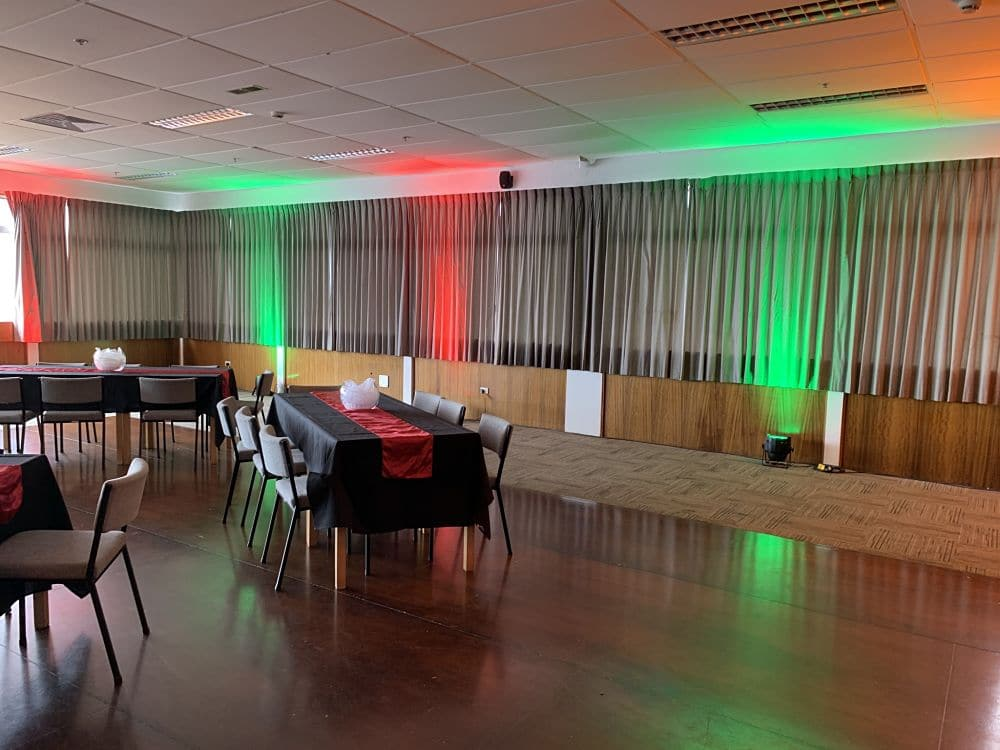 New Plymouth Club - Centennial Room Green and Red Up-lights