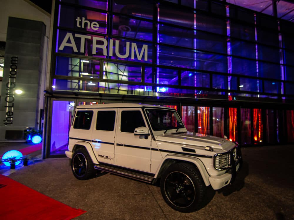 The Atrium - Entry doors with vehicle parked outside