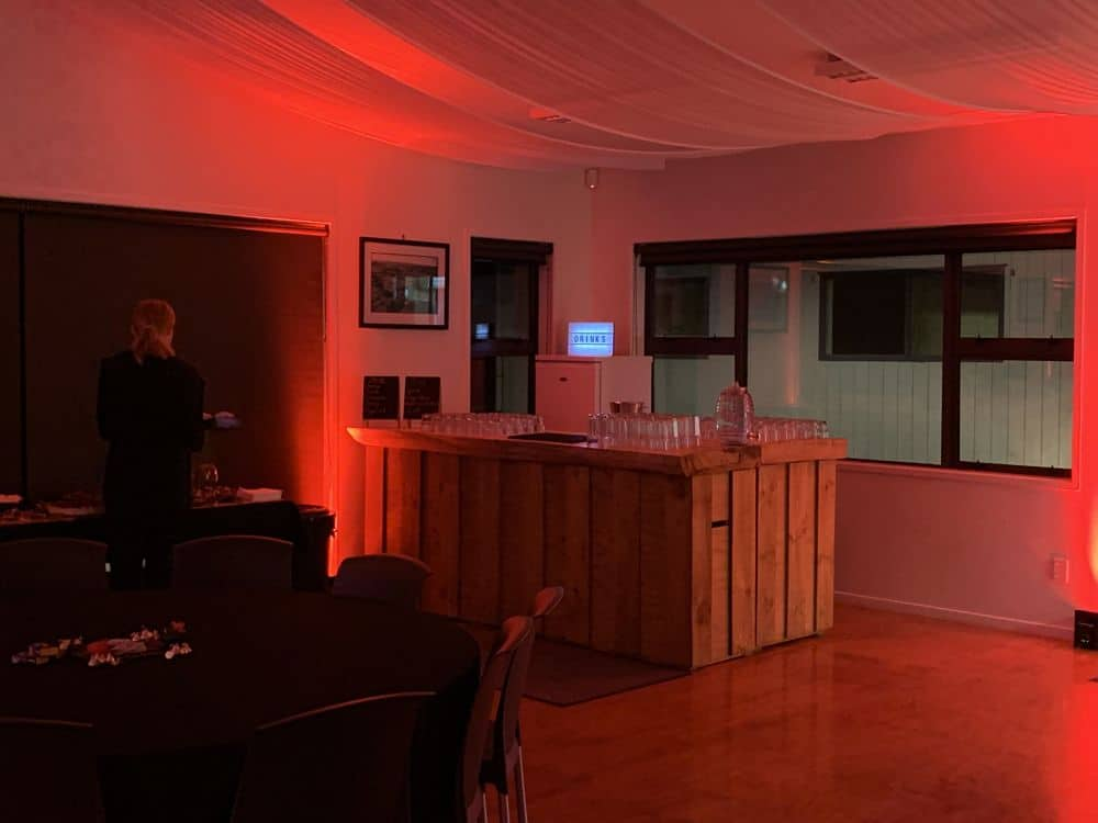 Waverly On Wairoa Function Room Bar Decorated in Orange Lights