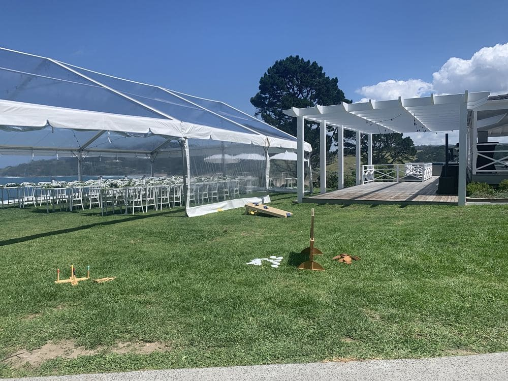 Orua Beach House - Marquee set for wedding and out door games set on lawn