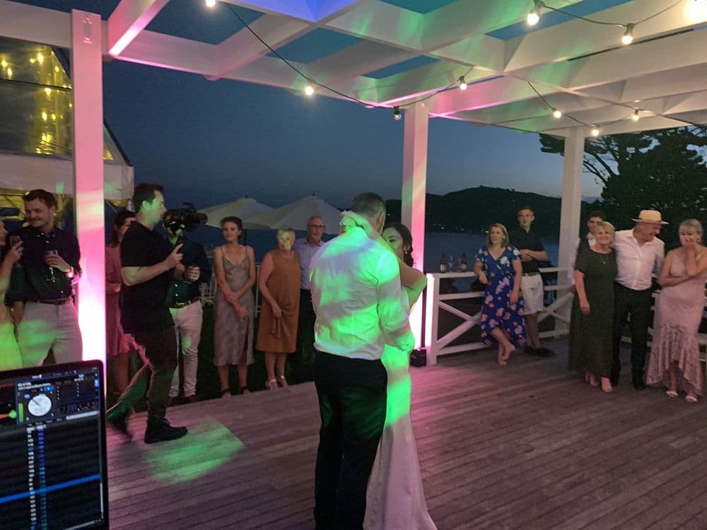 Orua Beach House - Bride and Groom first dance on deck